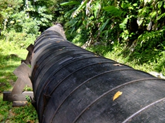 Water flows through it (an old but effective means of distributing water throughout the island of Dominica)