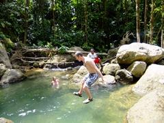 Robby jumping into the natural pool; Trafalgar Falls