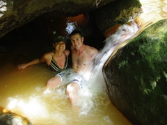 Soaking in the scalding hot springs at the base of Trafalgar Falls