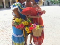 Robby smiles from ear to ear while getting kissed by two beauties; Havana Vieja