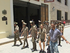 Military members strolling the streets of Havana