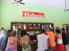 Locals crowd the corner Cafe Habana