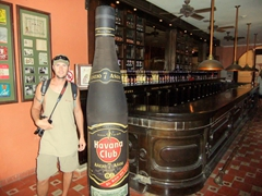 Robby posing beside 7 year rum at the Havana Club Museum of Rum, (Museo del Ron)