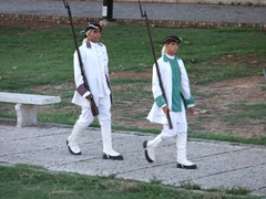 Soldiers dressed in colonial garb get ready to perform the nightly canonazo at El Morro
