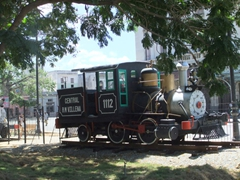 Old steam engine trains are retired in a park just across from the Havana Train Station