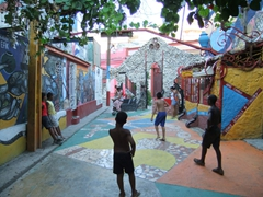 Boys playing an impromptu game of street soccer at Salvador's Alley, a Santeria religious area