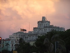 The sky turns a beautiful pinkish purple over the Prado as the sun sets