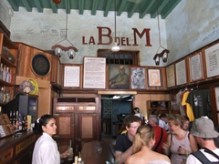 Tourists enjoy mojitos at Ernest Hemingway's favorite Havana joint, La Bodeguita del Medio