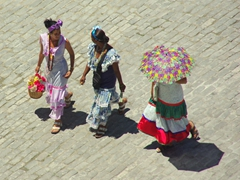 Flower girls of Havana strolling across Plaza de San Francisco