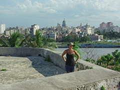 Becky at El Morro with the gorgeous skyline of Havana to her rear