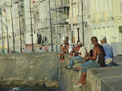 Fishermen try their luck along the malecon
