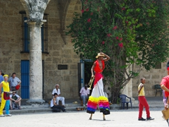 Colorful stilt walkers parade Havana Vieja, playing loud boisterous music and catching the crowd's attention everywhere they go
