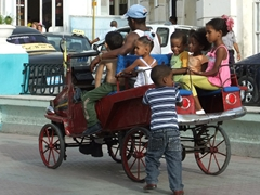 Kids enjoy a ride around Parque Cespedes
