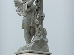 A marble angel headstone; Cementerio De Santa Ifigenia
