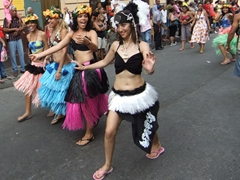 Young girls having a blast putting on a show for the cheerful crowd; Fiesta del Fuego