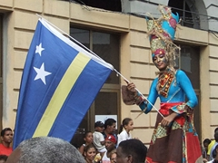 A graceful Curacao stilt walker towers over the rest of the festival participants