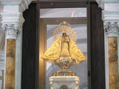 """The Basilica del Cobre houses the """"Black Virgin"""", dressed in yellow with a gold crown encrusted with diamonds, emeralds and rubies. She was blessed by the Pope in 1998"""