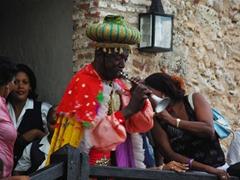 A colorful musician blows his horn; Fiesta del Fuego at El Morro