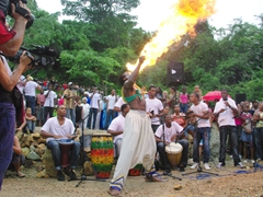A fire breather enthralls the crowd; Loma del Cimarron