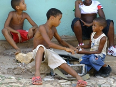 Boys fighting over a drum stick; streets of Trinidad