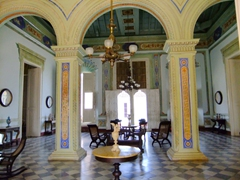 Entrance hall of Museo Historico Municipal, filled with gorgeous antiques