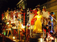 Young kids get into the festive spirit on a float during Fiestas Sanjuaneras