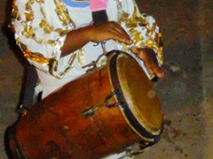 A young boy beats his drum; Fiestas Sanjuaneras