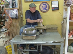 The owner of Casa del Alfarero, a ceramic workshop, shows us how he makes his signature show pieces