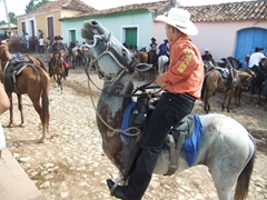 Cowboys overrun the cobble stoned streets of Trinidad during Fiestas Sanjuaneras