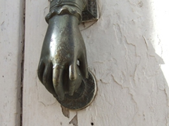 A brass door knocker