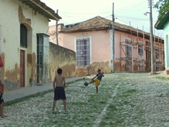 Boys will be boys; playing soccer in Trinidad's streets (barefoot no less!)