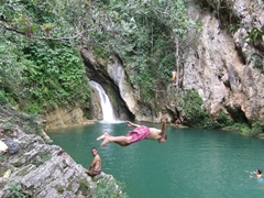 Robby dives into the refreshing pool at Topes de Collantes