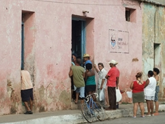 Trinidadians line up to receive some scarce, government rationed supply