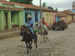 Cowboys race up and down Trinidad's streets during the lively Fiestas Sanjuaneras