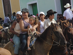 The ladies also get into the local fiesta, crowding upon their horses and prancing up and down the streets