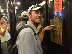 While waiting for the elevator doorman who never showed, Robby goofs around at Camaguey's Gran Hotel