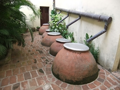 Several large tinajons used to collect rainwater; Casa Natal Ignacio Agramonte