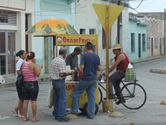 Locals getting a refreshing beverage; streets of Camaguey