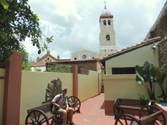 Robby sitting in the courtyard of La Bodega with a view of the Iglesia Parroquial Mayor de San Salvador in the background
