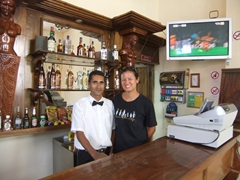 Our friendly bartender (who made super strong drinks) poses with Becky in quaint Bayamo; El Esquina Bar
