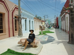 "Becky takes a breather on a bench in the scenic General Garcia pedestrian street (known as ""El Bulevar""); Bayamo"