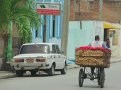 Young man transporting a load of bread; Bayamo