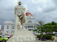 Marble lion statue standing guard; Plaza Marti