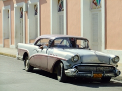 A classic car cruising the streets of Cienfuegos