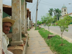 An older man watches the world go by in sleepy Vinales