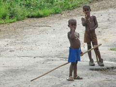 Two young boys with their fishing poles stop to check us out; Vinales