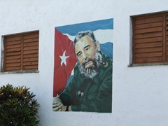 Mural of Fidel Castro on the side of a Baracoa building