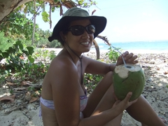 Becky enjoying a coconut drink at Playa Maguana