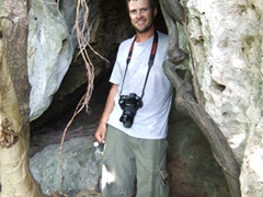 Robby posing in a cave at the Museo Arqueologico