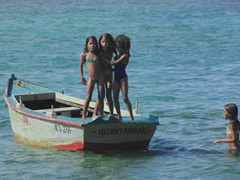 These girls spent countless hours jumping from the boat into the water and had a blast doing it; Playa Manglito